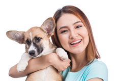 Young asian woman with a little puppy isolated over a white back stock image