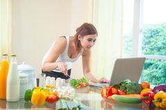 Young asian woman looking for a recipe Royalty Free Stock Photography