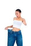 Young Asian woman losing weight by living healthy Royalty Free Stock Photos