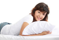 Young asian woman lying on the bed Royalty Free Stock Photo