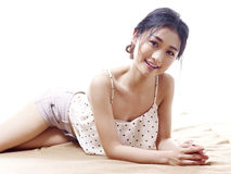 Young asian woman lying on floor Royalty Free Stock Images