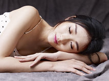 Young asian woman lying on floor Royalty Free Stock Photo