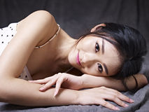 Young asian woman lying on floor Royalty Free Stock Photos
