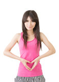 Young asian woman make heart shape on her belly Stock Photos