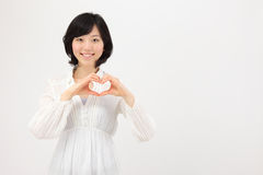 Young Asian woman making heart with hands Stock Photos