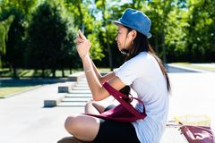 Young Asian woman making selfie pictures Royalty Free Stock Photo