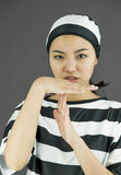 Young Asian woman making time out signal with hands in prisoners uniform Royalty Free Stock Photography