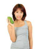 Young asian woman with a mango over white. Stock Photos