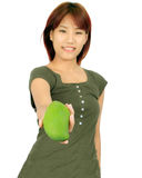 Young asian woman with a mango over white. Stock Images