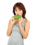 Young asian woman with a mango over white. Stock Photography