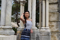 Young Asian Woman at Medieval Ruins. A young Asian woman poses at a medieval ruins site Royalty Free Stock Image