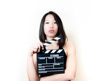 Young asian woman and movie clapper board Royalty Free Stock Photography