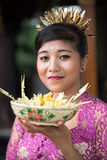 Young Asian woman with offering for gods Royalty Free Stock Images