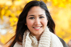 Young Asian woman outdoor autumn portrait Royalty Free Stock Photography