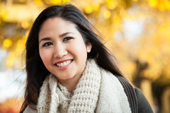 Young Asian woman outdoor autumn portrait Stock Photos