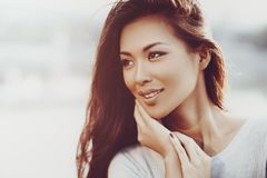 Young asian woman. Outdoors portrait in soft warm colors Royalty Free Stock Photos
