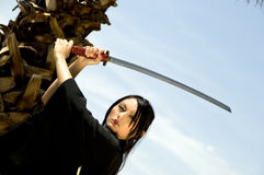 Young Asian Woman Outside with Katana Stock Image