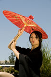 Young Asian Woman Outside with Umbrella Royalty Free Stock Image