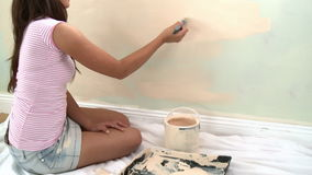 Young asian woman painting a room stock video
