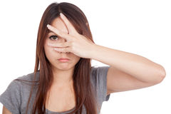 Young Asian woman  peeking though her fingers Royalty Free Stock Photography