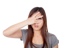 Young Asian woman  peeking though her fingers Royalty Free Stock Photo