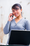 Young Asian woman on phone Stock Image