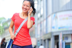 Young asian woman on the phone Royalty Free Stock Photos