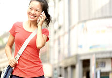 Young asian woman on the phone Stock Photography