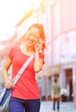 Young asian woman on the phone Royalty Free Stock Photo