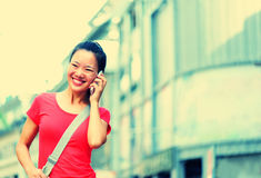 Young asian woman on the phone Royalty Free Stock Photography