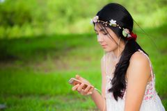 Young asian woman picnic on the meadow stock image