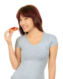 Young asian woman with a piece of pizza Stock Images