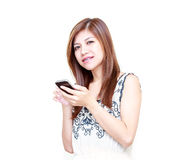 Young Asian Woman playing on her mobile phone Stock Images
