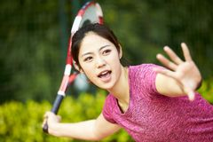 Young asian woman playing tennis royalty free stock photo