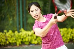 Young asian woman playing tennis stock image