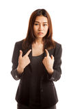 Young Asian woman point at herself ask why me. Royalty Free Stock Photo