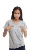 Young Asian woman point at herself ask why me. Royalty Free Stock Images
