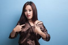 Young Asian woman point at herself ask why me. Stock Photography
