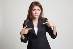 Young Asian woman point at herself ask why me. Stock Photos