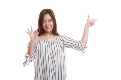 Young Asian woman point and show OK. Royalty Free Stock Images