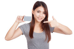 Young Asian woman point to blank card Royalty Free Stock Images