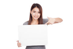 Young Asian woman point to blank sign Stock Photo