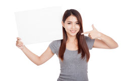 Young Asian woman point to blank sign Stock Images