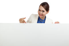 Young Asian woman point to a  blank sign Stock Image
