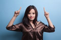 Young Asian woman point to blank space. Royalty Free Stock Photo