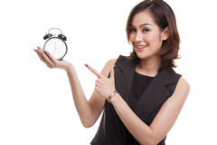 Young Asian woman point to a clock. Stock Photos