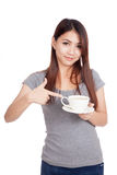 Young Asian woman point to cup of coffee Royalty Free Stock Image