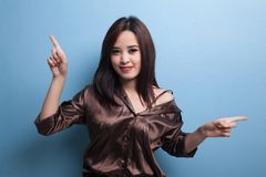 Young Asian woman point with two hands. Royalty Free Stock Photo
