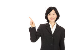 Young asian woman pointing Royalty Free Stock Photography