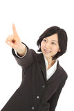 Young asian woman pointing Stock Photo